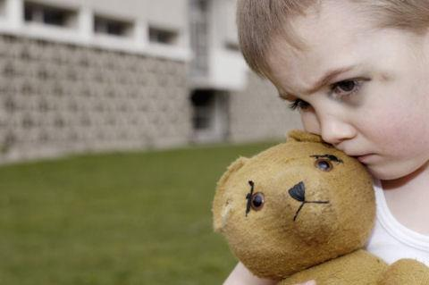 abused-child-with-teddy-bear